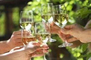 9642846-celebration-people-holding-glasses-of-white-wine-making-a-toast-shallow-dof-0a60e289-d530-4322-b7d3-3b3ab5e07f0d-0-400x267